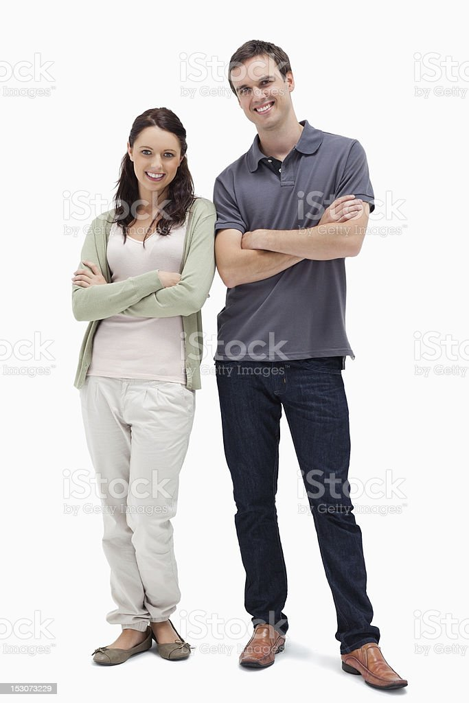 Smiling couple crossing their arms royalty-free stock photo