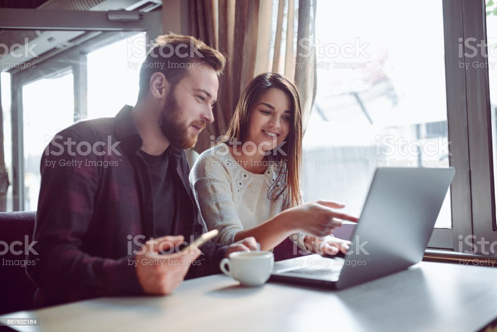 Smiling Couple Drinking Coffee and Making Video Conference in the Morning stock photo
