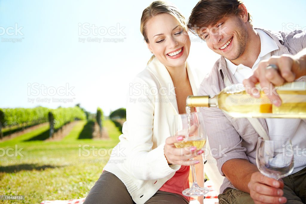 Smiling couple drinking white wine on a perfect date royalty-free stock photo