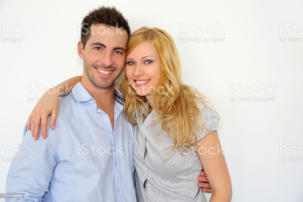 Smiling couple embracing each other at home royalty-free stock photo