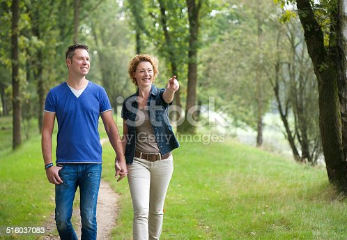Portrait of a smiling couple enjoying a walk outdoors