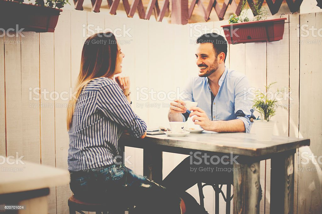 Smiling couple enjoying in the bar stock photo