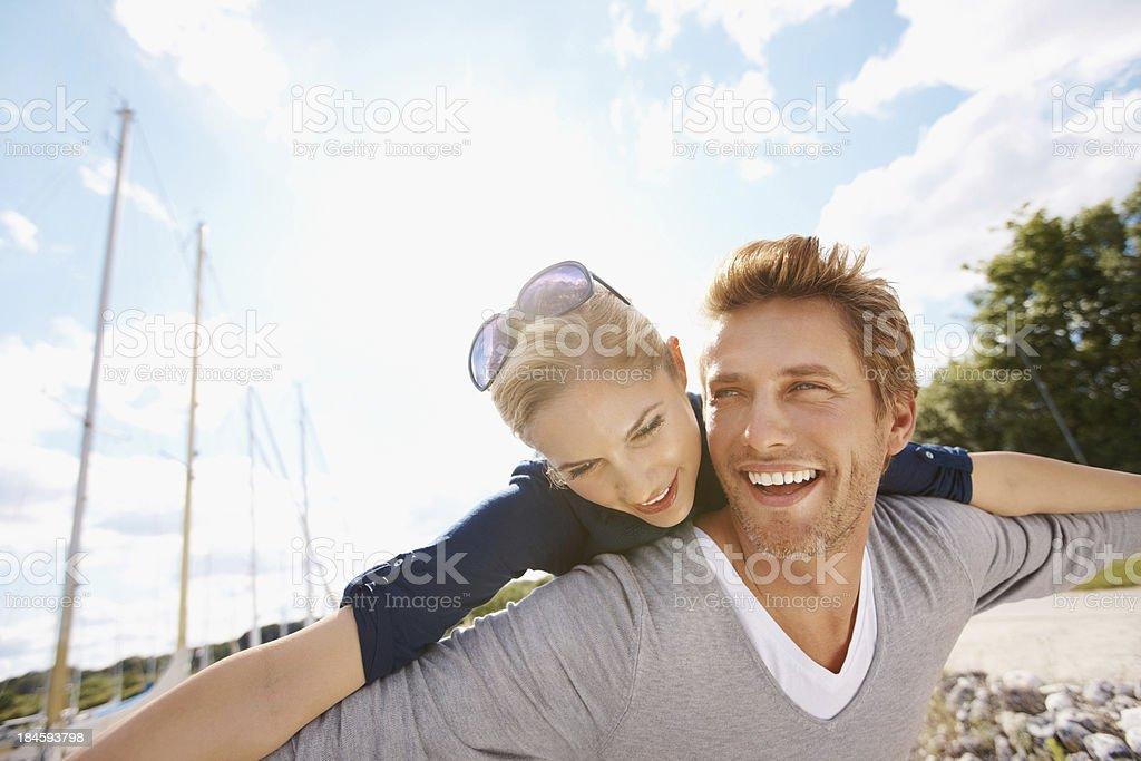 Smiling couple enjoying the harbor side royalty-free stock photo