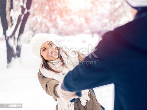 Smiling couple enjoying the winter