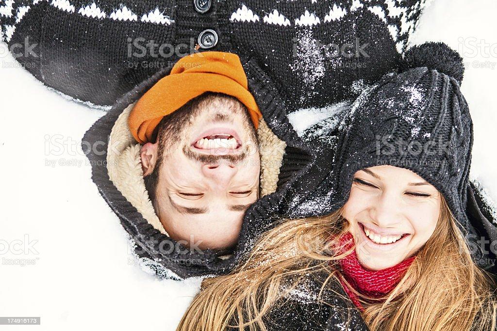 Smiling couple enjoying the winter royalty-free stock photo