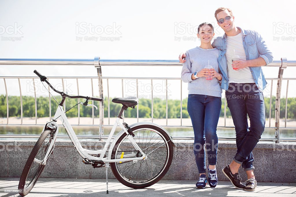 Smiling couple having a drink royalty-free stock photo