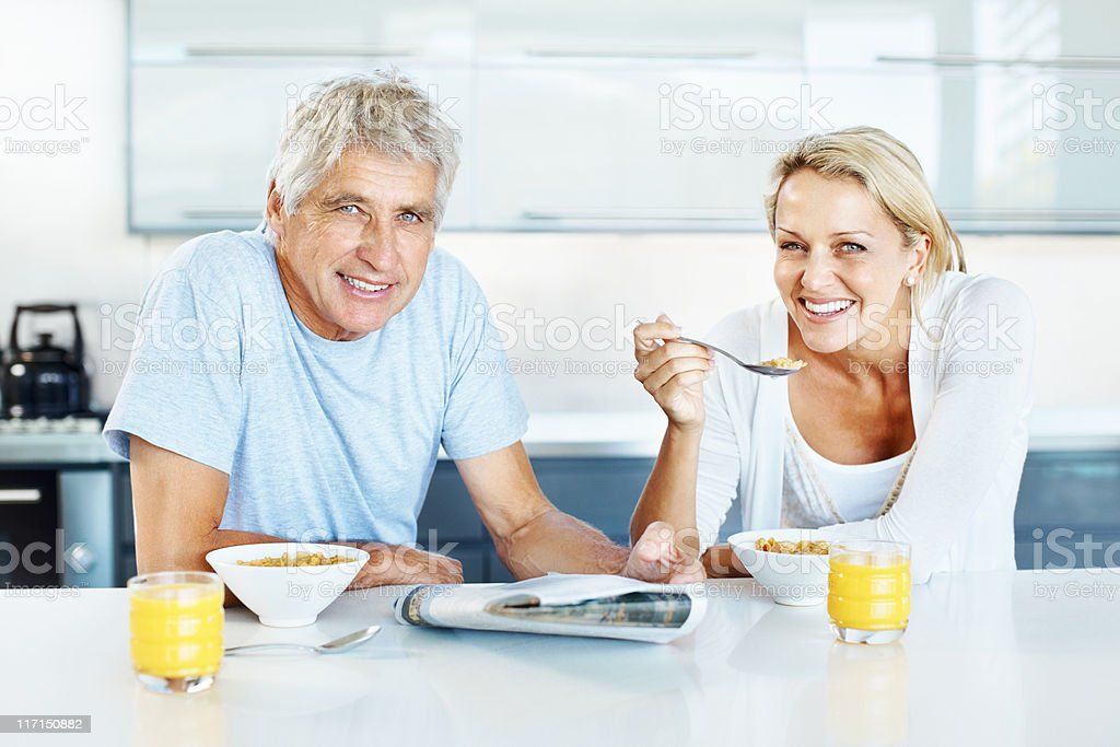 Smiling couple having breakfast royalty-free stock photo