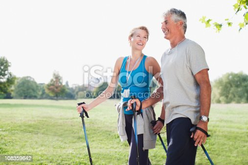 istock Smiling couple hiking together 108359642