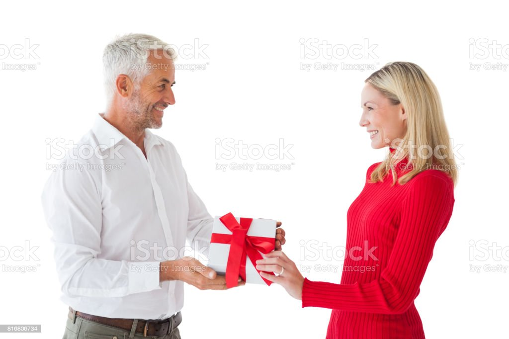 Smiling couple holding a gift stock photo