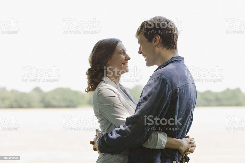 Smiling couple hugging outdoors royalty-free stock photo