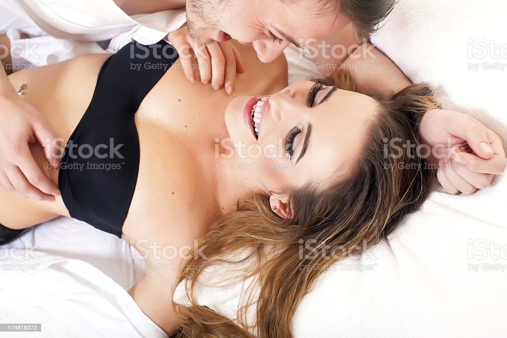 Smiling couple in a bedroom royalty-free stock photo