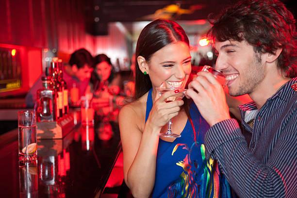 Smiling couple in nightclub with beverage picture id482911935?b=1&k=6&m=482911935&s=612x612&w=0&h=htg4jekhfcheyvxi pg4ilu6lnyxhiouxzkw vxxjpq=