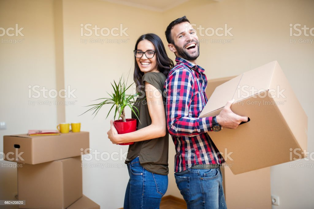 Smiling couple in their new home royalty-free stock photo