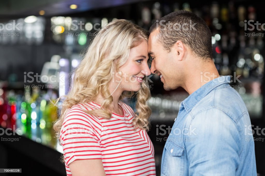 Smiling couple looking at each other stock photo