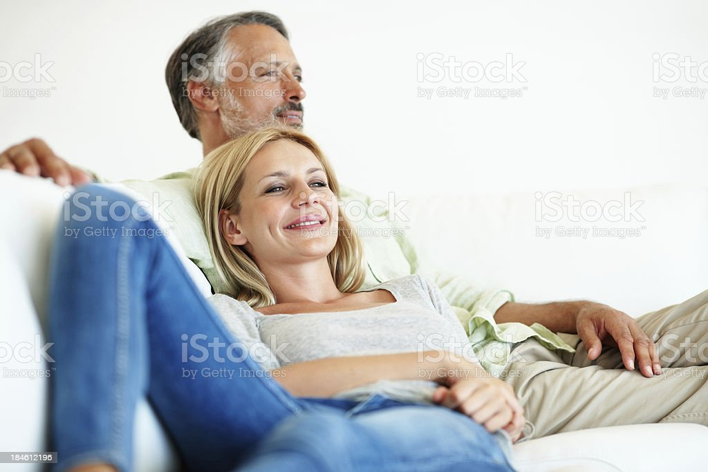Smiling couple lying on couch royalty-free stock photo