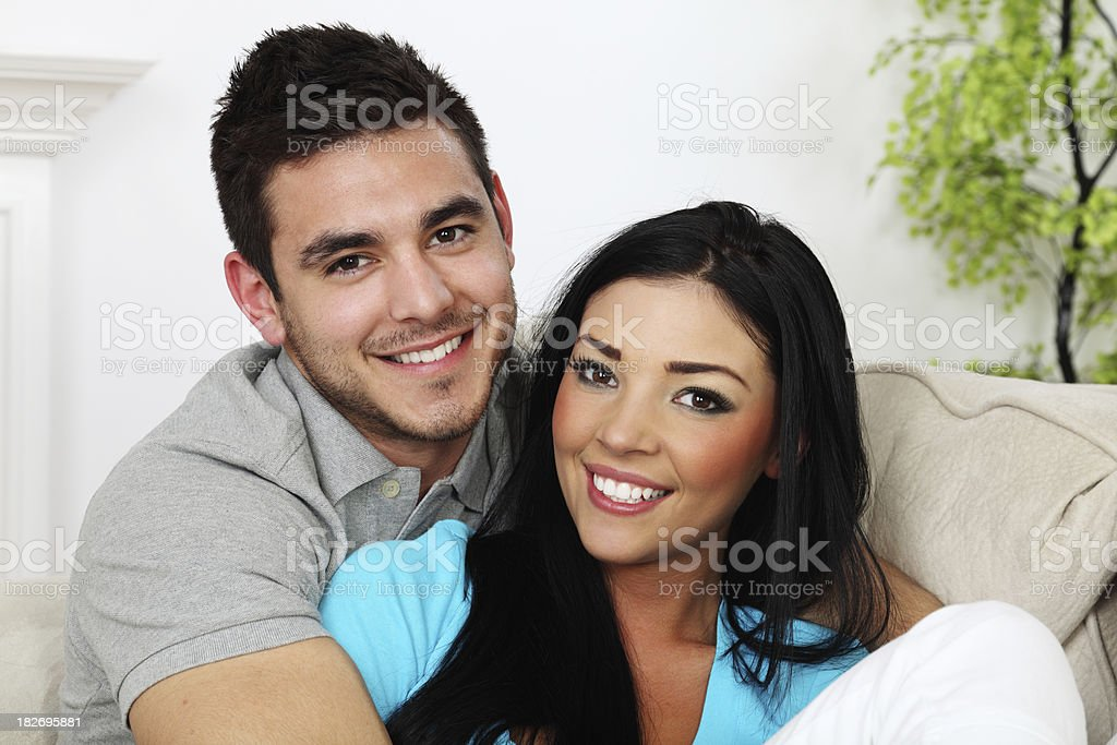 Smiling Couple On Sofa stock photo