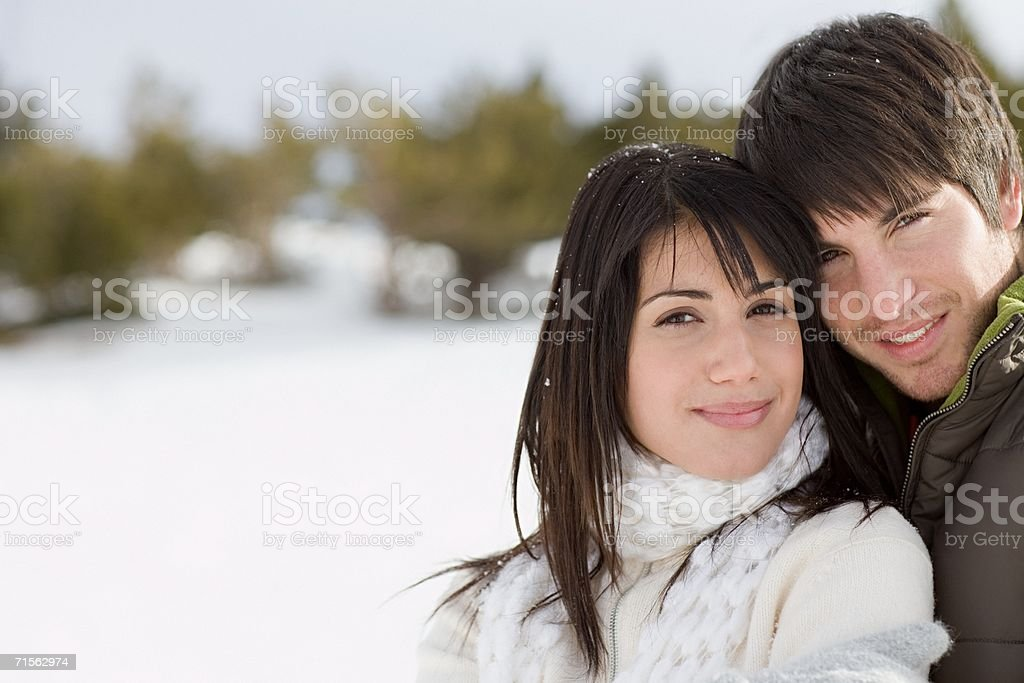 Smiling couple on winter vacation royalty-free stock photo