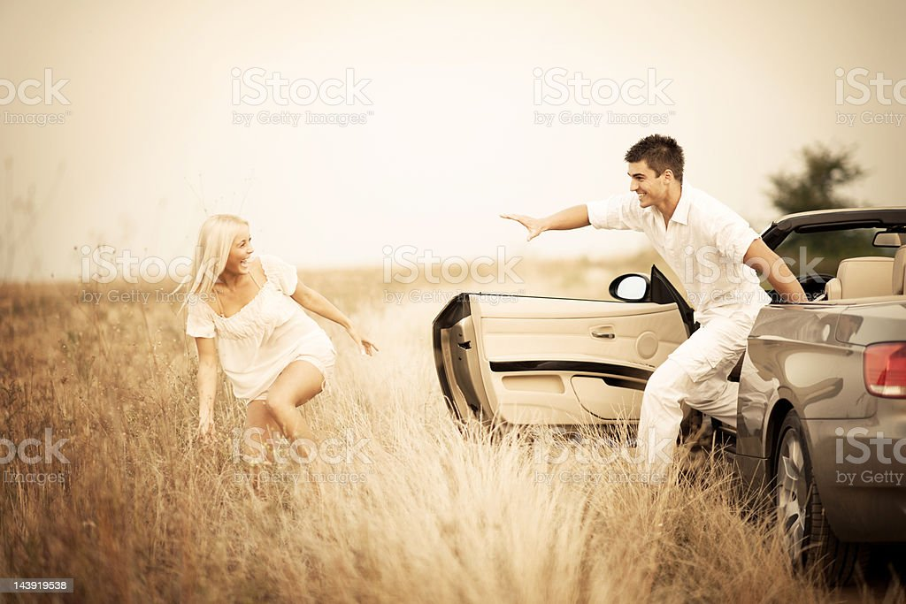 Smiling couple playing tag. royalty-free stock photo