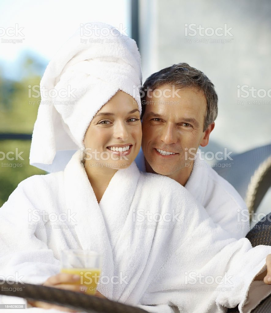 Smiling couple sitting at outdoors spa royalty-free stock photo