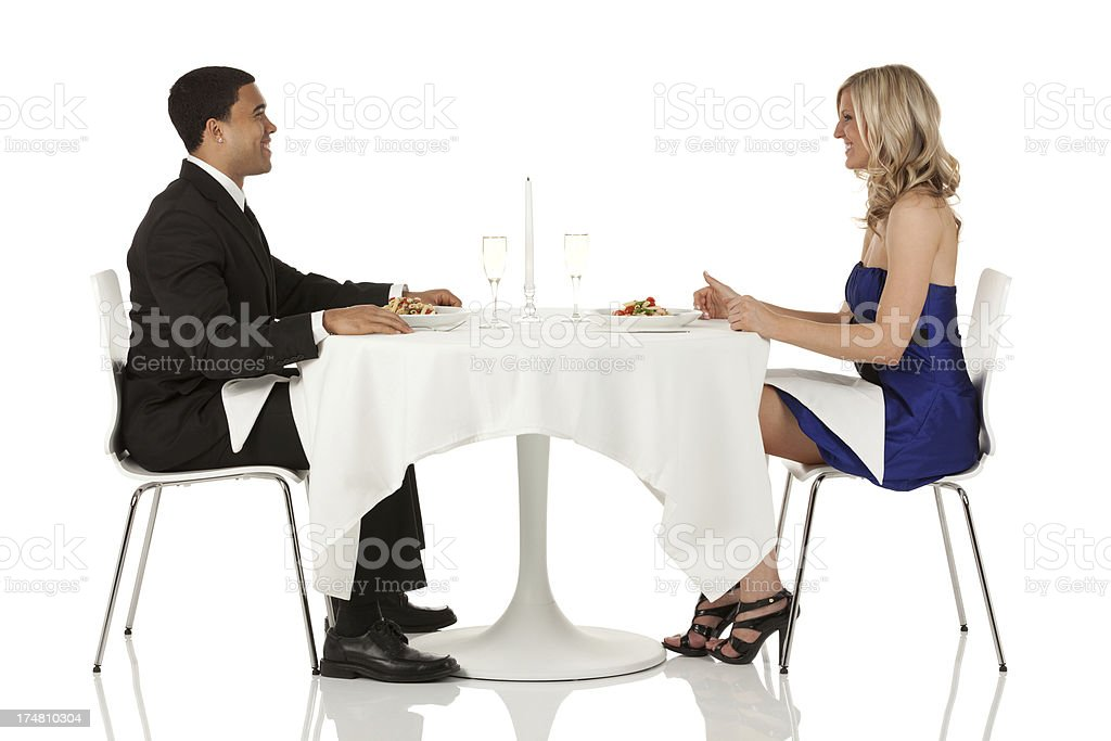Smiling couple sitting in a restaurant royalty-free stock photo