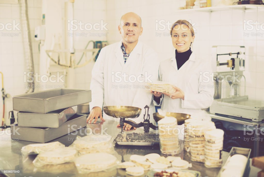 Smiling couple standing with box of turron stock photo