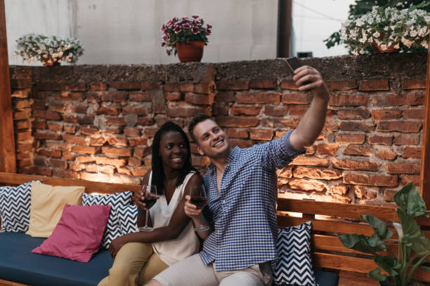 Smiling couple taking selfie stock photo