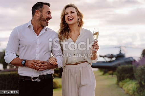 istock Smiling couple walking outdoors 961730902