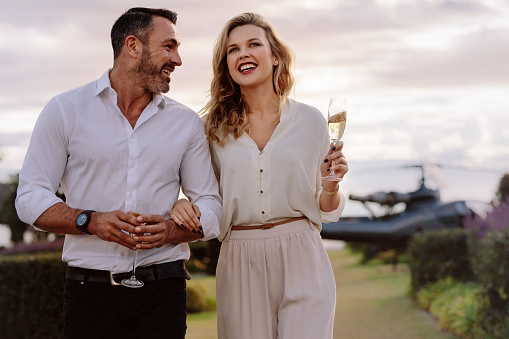 Smiling Couple Walking Outdoors Stock Photo - Download Image Now