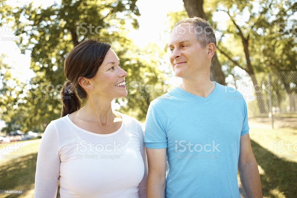 Smiling couple walking together royalty-free stock photo