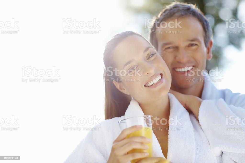 Smiling couple with fresh juice royalty-free stock photo