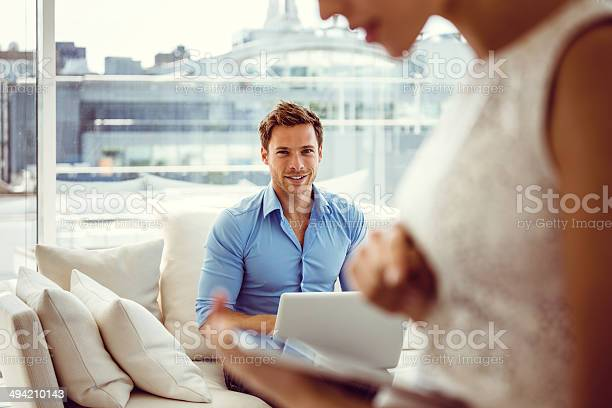 Smiling Couple With Technologies Stock Photo - Download Image Now