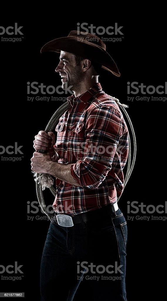 Souriant cowboy Regarder ailleurs photo libre de droits