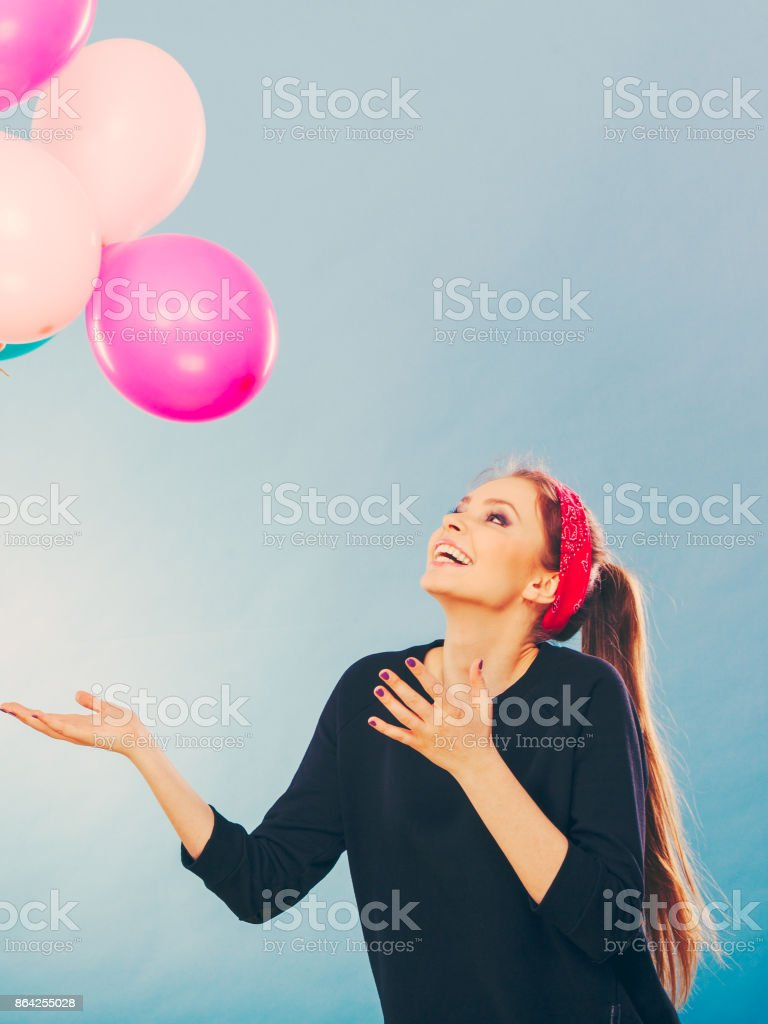 Smiling crazy girl having fun with balloons. royalty-free stock photo