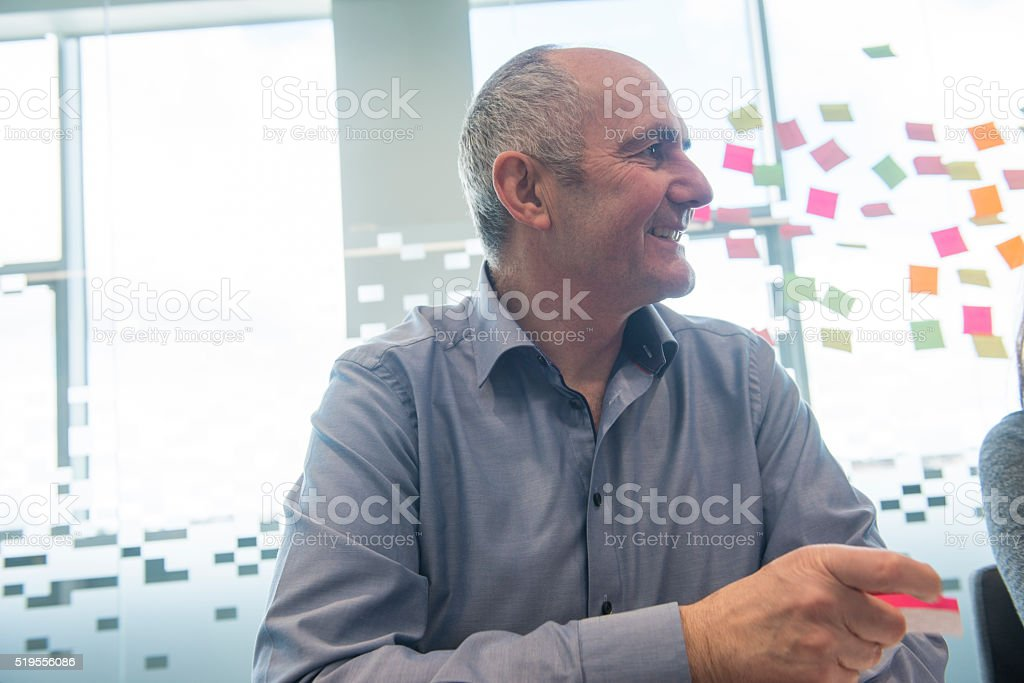 Smiling creative in meeting royalty-free stock photo