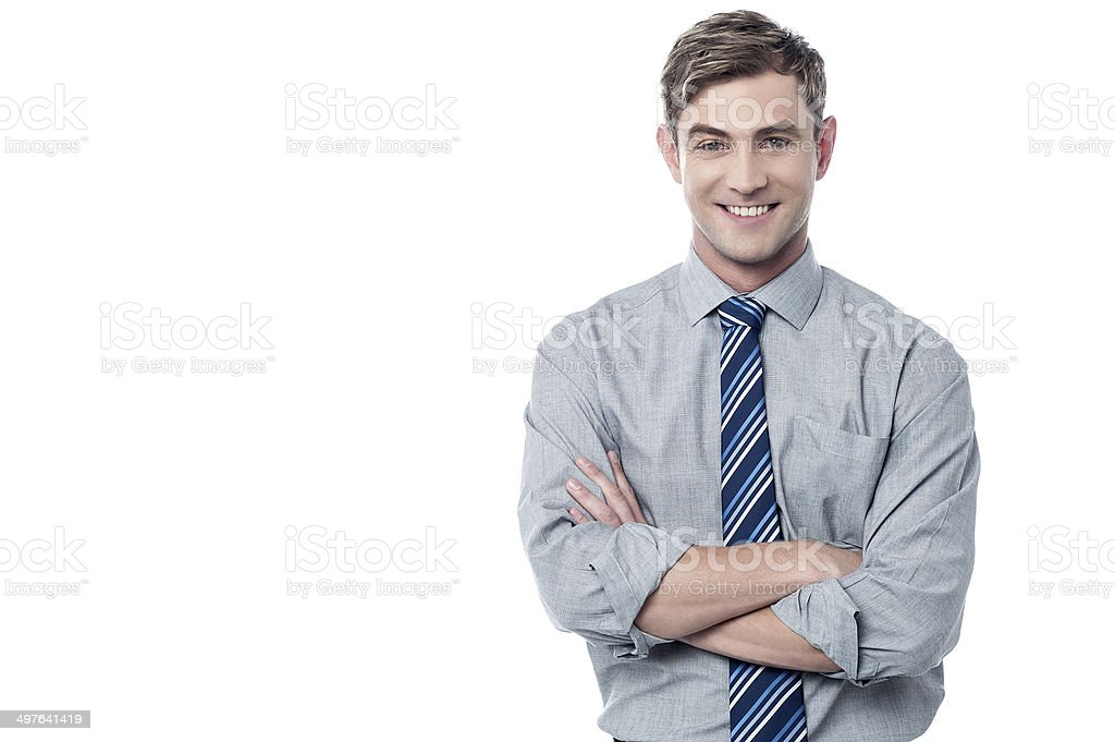Smiling crossed arms corporate executive stock photo
