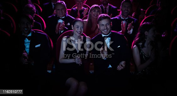 483876497 istock photo Smiling crowd applauding while watching opera 1162510777
