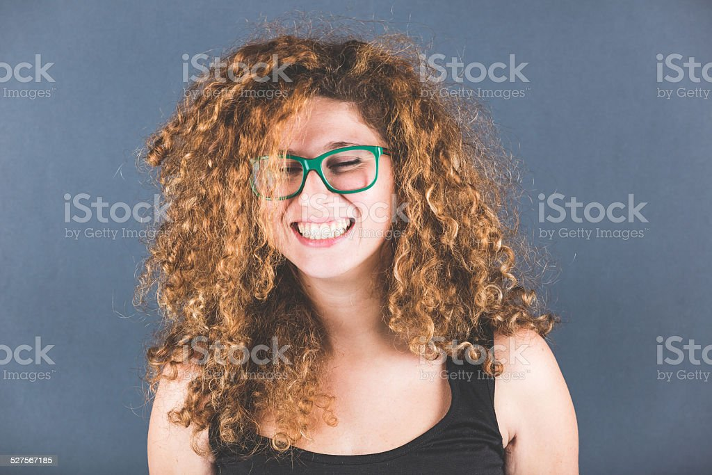 Smiling Curly Young Woman Portrait stock photo