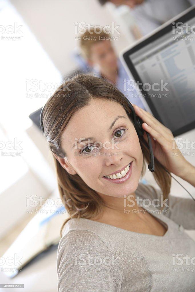 Smiling customer representative at work stock photo