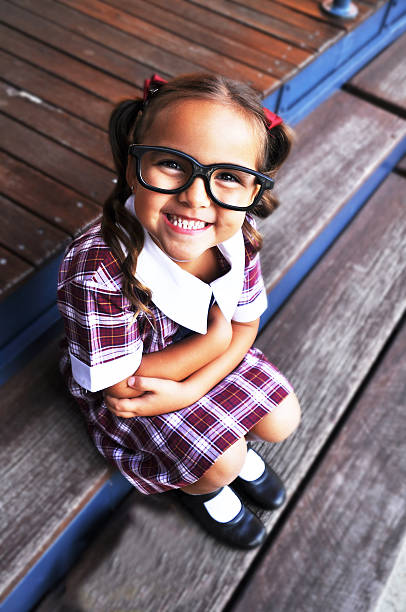 Smiling Cute Geeky girl Cute geeky girl smiling at camera. nerd hairstyles for girls stock pictures, royalty-free photos & images