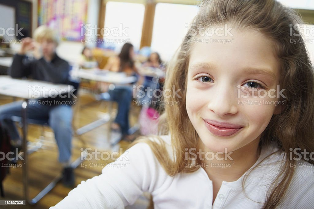 Smiling cute girl with friends in the background stock photo