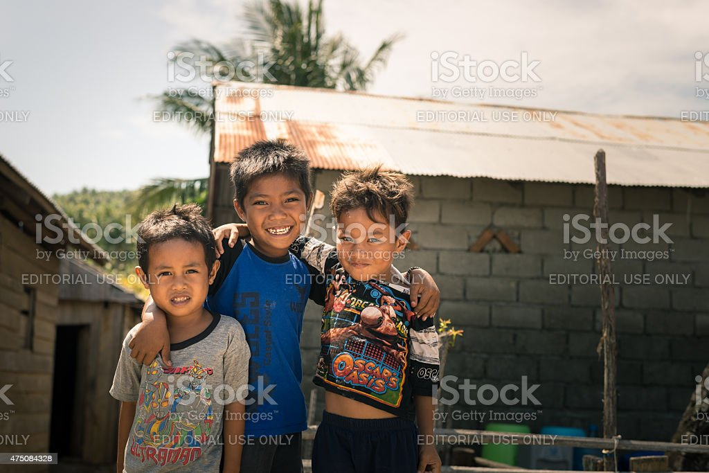 Smiling cute young boys in slum, Indonesia stock photo