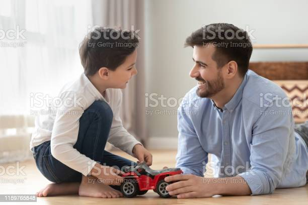 Smiling dad and son playing racing cars at home floor picture id1159765848?b=1&k=6&m=1159765848&s=612x612&h=897pplvzil sc9gfbkhjwfiks6m5tykfmtc5xmlj4dg=