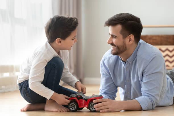 Smiling dad and son playing racing cars at home floor picture id1159765848?b=1&k=6&m=1159765848&s=612x612&w=0&h=xvgmewaazlhto fwbyrrmogab bonzqbvrggosecr7e=