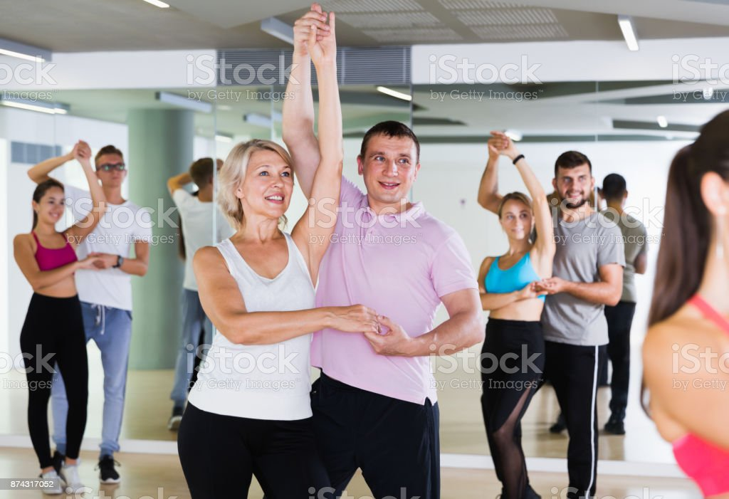 Smiling dancing pair dance  together stock photo