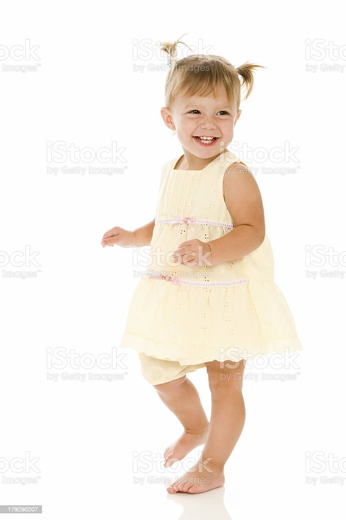 Smiling Dancing Toddler Girl stock photo