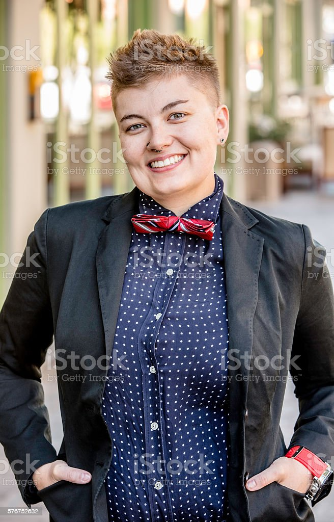 Smiling Dapper Gender Fluid Young Woman stock photo