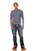 istock Smiling dark-skinned young man in jeans and a blouse 532111865