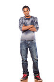 istock Smiling dark-skinned young man in jeans and blouse 531643911