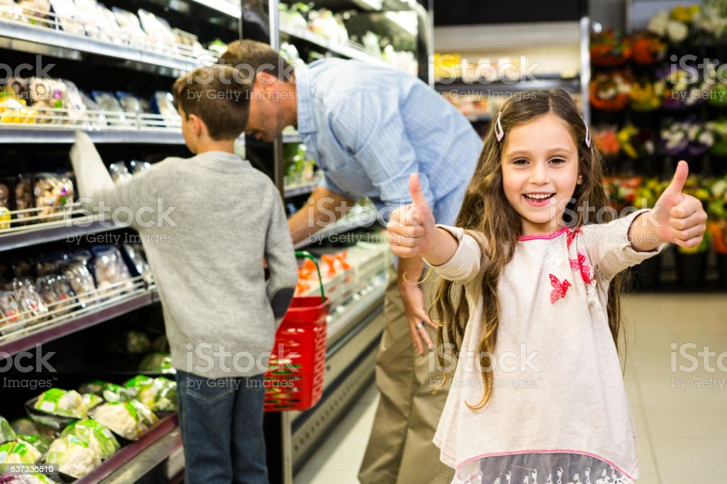 Smiling daughter with thumps up stock photo