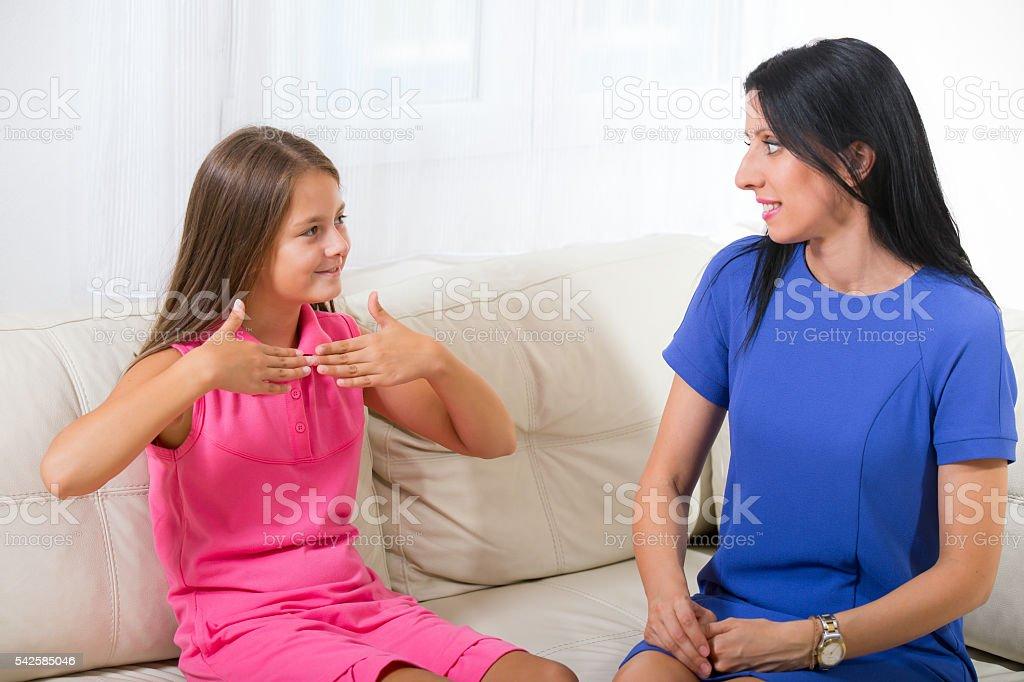Smiling deaf girl learning sign language stok fotoğrafı